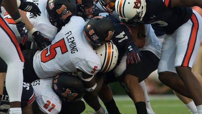 Auburn defensive back Stephen Roberts (14) is tackled during the NCAA Football game between Auburn and Mercer on Saturday, Sept. 16, 2017, in Auburn, Ala. Auburn defeated Mercer 24-10.