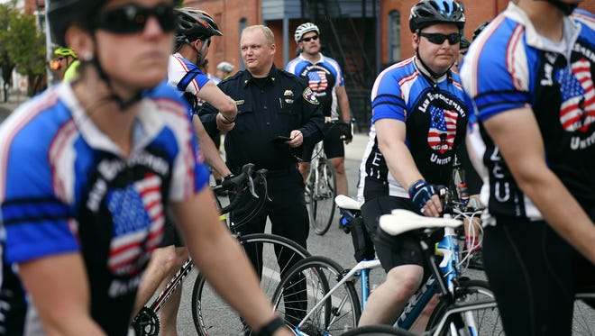 York City Police chief Troy Bankert, center, greets a Police Unity Tour participant before the group departed Thursday outside the York City Police station. The 2018 Police Unity Tour, comprised of about 80 police officers on bicycles, made a detour to come through York on its way to Washington, D.C., after York City Police officer Alex Sable died Wednesday after suffering a cardiac arrest while participating in a training exercise in Baltimore County, Maryland.