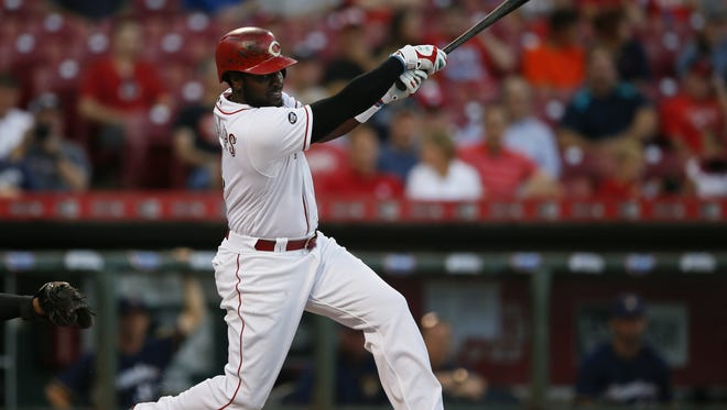 Cincinnati Reds second baseman Brandon Phillips (4) reaches first on an infield single in the first inning during the MLB National League game between the Milwaukee Brewers and the Cincinnati Reds, Monday, Sept. 12, 2016, at Great American Ball Park in Cincinnati.