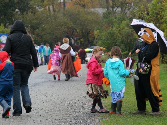 Kids and  their families trick-or-treat at the Shelburne Museum during Haunted Happenings on Sunday, Oct. 29, 2017.