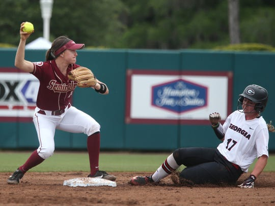 FSU's Ellie Cooper gets the force out a second base against Georgia's Maeve McGuire and looks to throw to first at JoAnne Graf Field on Saturday, May 20, 2017.