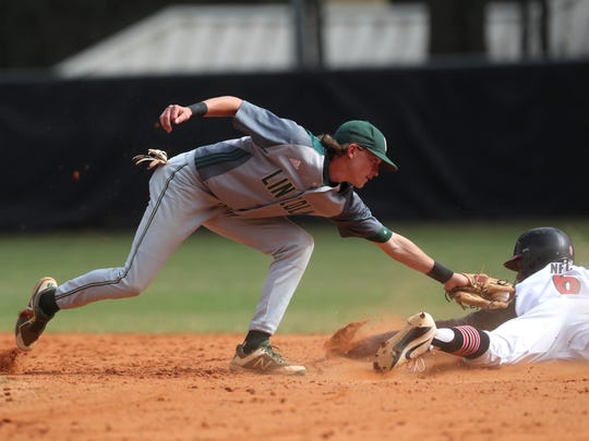 NFC's Brandon Walker slides safely under the tag of Lincoln's Nick Standridge during their game at NFC on Tuesday, April 24, 2018.