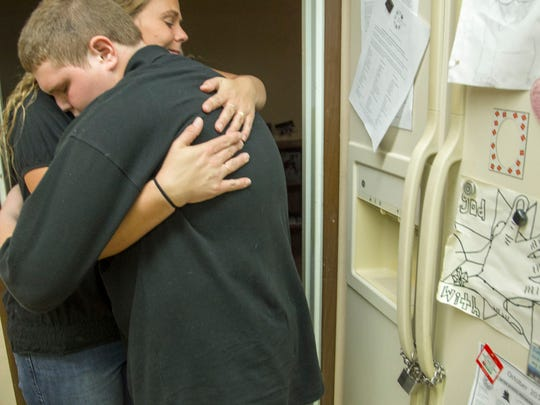 Misty Kidder, a Phoenix mother, hugs her son Austin Tautfest, 14, after he has minor episode of anger issue before he goes to bed. Kidder, said she has spent the past nine years fighting to get services for her son who has a pervasive developmental disorder and attention deficit issues that sometimes cause him to become agitated and violent.Kidder said agencies have told her a lack of funding prevents them from providing the teen with after-school care, and Kidder has been unable to receive respite services so she can get a break and spend additional time with her two daughters.Kidder said her daughters at times are afraid of their brother because of his outbursts, and the family has had to rely on police for assistance when he loses control amid the lack of mental-health care.Kidder added that said sheÕs furious at the amount of money being spent on executive compensation by mental-health providers while treatment lingers for patients like her son.Parents of children with behavioral disorders say they have been denied services or waited months for them because of diminished public funding that passes through the organizations in question. Mercy Maricopa Integrated Care, is the behavioral health authority overseeing funding in the Valley, replacing Magellan Health earlier this year.