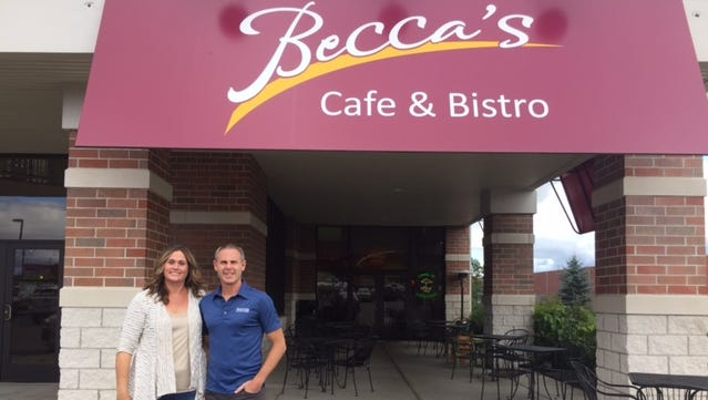 Rebecca and Jason Lowman in front of their restaurant, Becca's Cafe, in Rib Mountain.