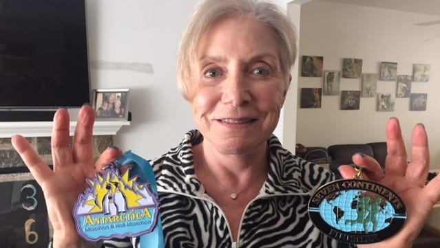 Sandy Barsha shows off her medals for completing the Antarctica Half-Marathon and making the seven-continents half-marathon club.