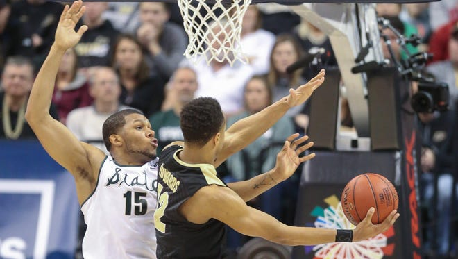 Michigan State's Marvin Clark Jr. defends against Purdue's Vince Edwards during the second half on Sunday, March 13, 2016, at Bankers Life Fieldhouse in Indianapolis. (Kirthmon F. Dozier/Detroit Free Press/TNS)