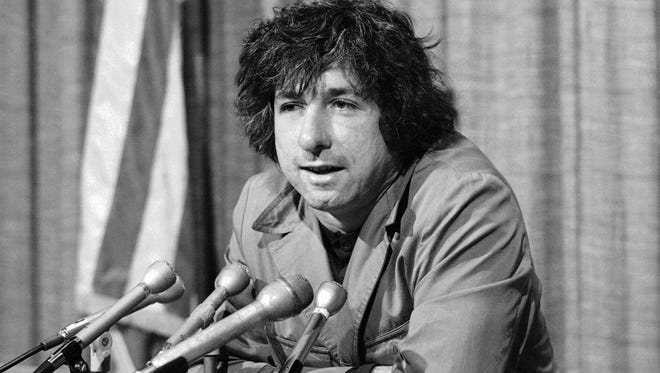 In this Dec. 6, 1973 file photo, political activist Tom Hayden, husband of Jane Fonda, tells newsmen in Los Angeles that he believes public support was partially responsible for the decision not to send him and others of the Chicago 7 to jail for contempt. Hayden, the famed 1960s anti-war activist who moved beyond his notoriety as a Chicago 8 defendant to become a California legislator, author and lecturer, has died at age 76. His wife, Barbara Williams, says Hayden died on Sunday, Oct. 23, 2016, in Santa Monica of a long illness.