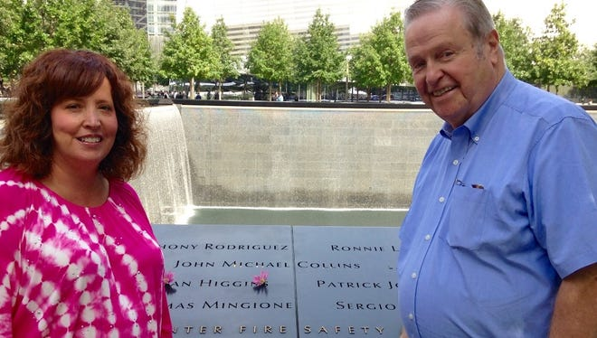 Trish Collins-Amo and her father, Martin Collins, at the Sept. 11 Memorial and Museum