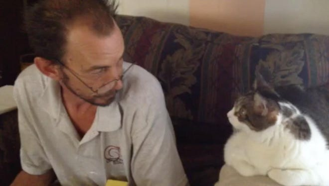 """Helmuth Bischel, of North Fort Myers, on his six cats: """"They mean everything to me."""""""