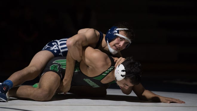 Piedra Vista's Nick Rino, top, grapples with Famrington's Francisco Alvarez on Thursday at the Jerry A. Conner Fieldhouse.