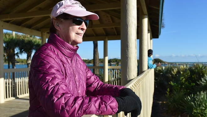 Anita Allen, a Fort Pierce winter resident from Middle Island, New York, stops to enjoy the view during a cold and windy morning walk in March along the boardwalk at Fort Pierce Beach. Temperatures on the Treasure Coast are expected to dip this weekend.
