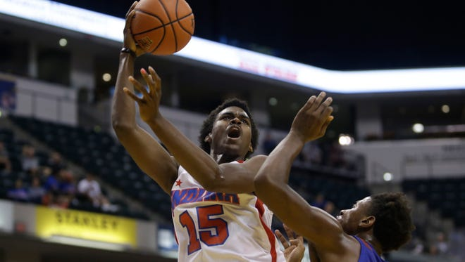 North Central's Kris Wilkes (15) and Bowling Green's Terry Taylor at the Indiana vs. Kentucky High School All-Star game Saturday at Bankers Life Fieldhouse.