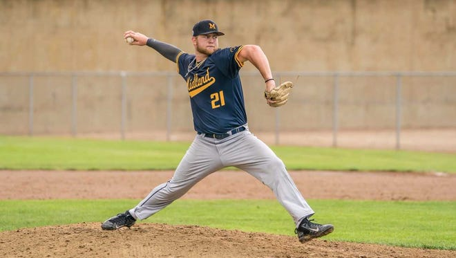 The Midland Redskins' Tyler Brown pitches against D-BAT Elite on Saturday at the Farmington Sports Complex.