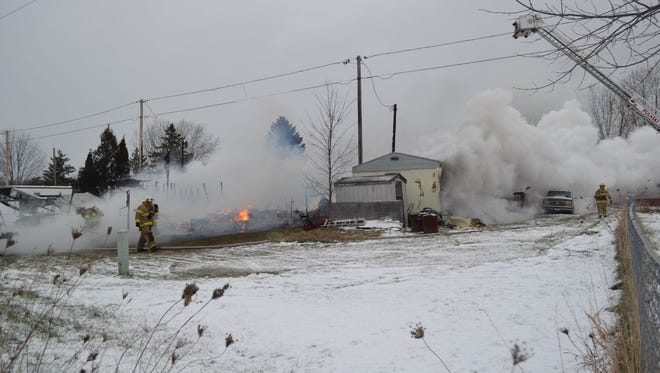Smoke billows from the remains of two mobile homes in a trailer park about 1.5 northeast of Pulaski in the town of Chase on Wednesday afternoon. Authorities said everyone at home at the time of the fire got out safely. A shed was also destroyed.