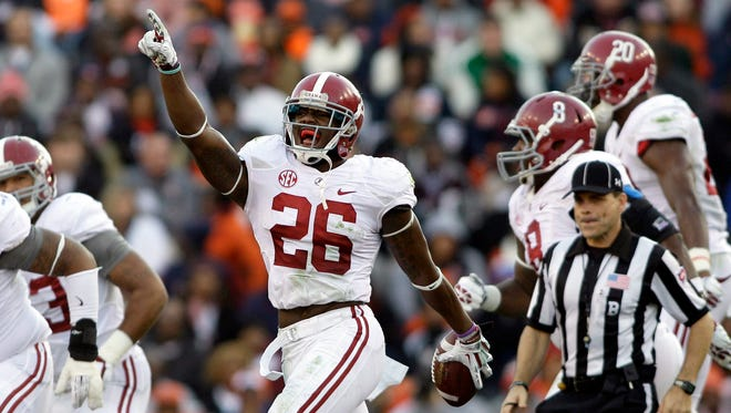 Safety Landon Collins (26) and the Alabama defense are looking to erase the last taste they left in fans' mouths.