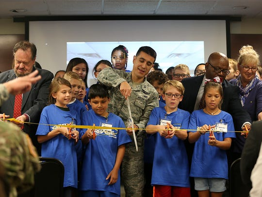 Col. Ricky Mills, 17th Training Wing commander at Goodfellow Air Force Base, along with fifth graders from Santa Rita Elementary and community representatives cut the ribbon dedicating a building on base for the newly implemented STARBASE program Oct. 4. 2017.