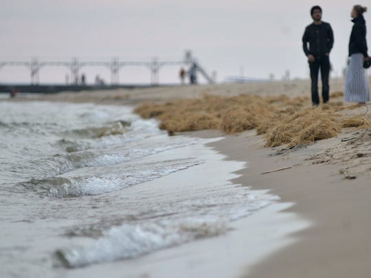 People enjoy the beach at Grand Haven State Park May