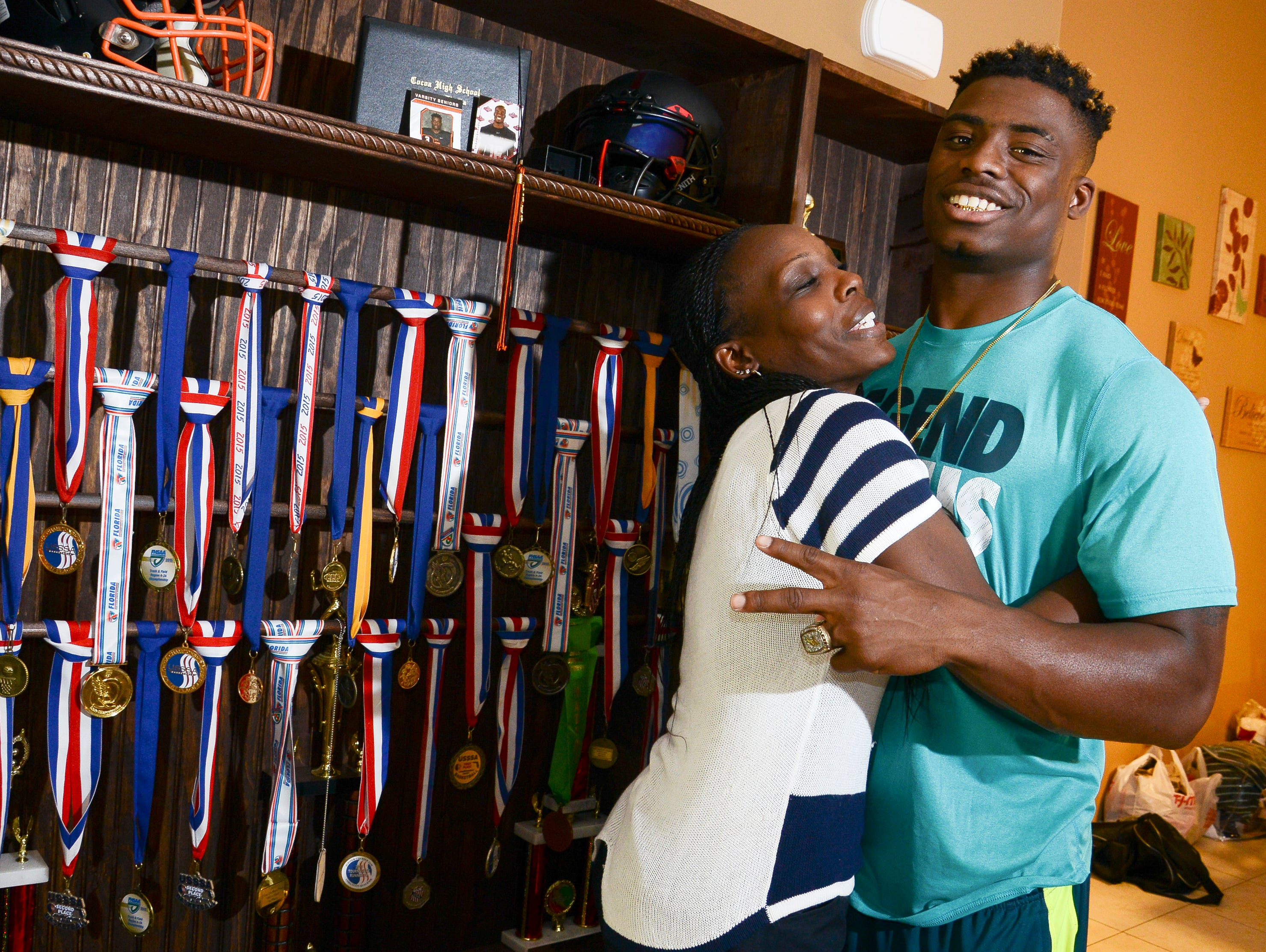 Chauncey Gardner stands with his mother Delatron Johnson in their Cocoa home.