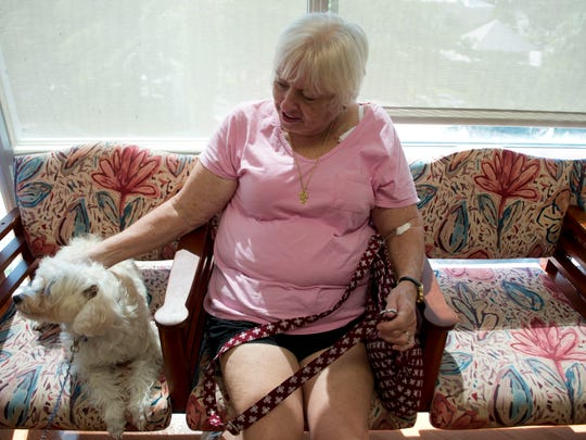 """Breast cancer survivor Patsy Lord, of Stuart, pets Sassy, a therapy dog at Martin Medical Center for about eight years, on Friday, Sept. 16, 2016, at the Robert and Carol Weissman Cancer Center in Stuart. """"I look forward to coming here,"""" Lord said. Though the pet therapy dogs have been visiting patients for years, the hospital has begun offering other forms of alternative treatment, including yoga for cancer patients."""