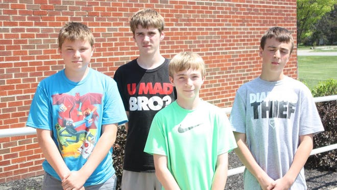 John Holzaepfel, Javion Large, Logan Faulkner and Ryon Nelson established a school record in the 4X200 relay for Danbury Middle School.