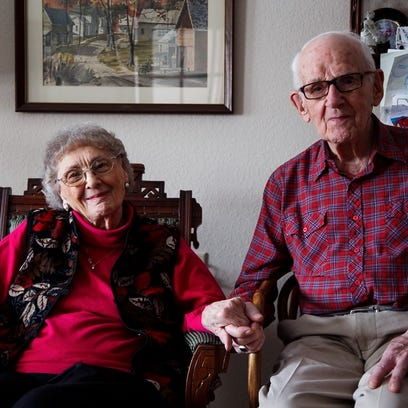 Peg and Ken Newell sit for a portrait in their apartment
