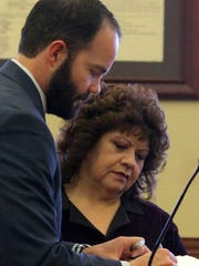 Luna County Clerk Andrea Rodriguez looks over paper work with the Honorable Judge Jarod K. Hofacket.