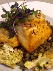 Salmon with lentils, shallots, roasted cauliflower and chimichurri sauce at Penn & Palate.