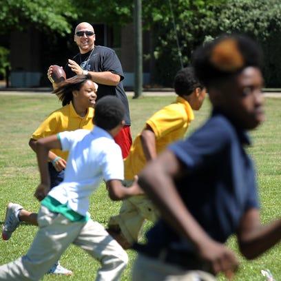 Hawkins Elementary School coach Terrance Bembry plays