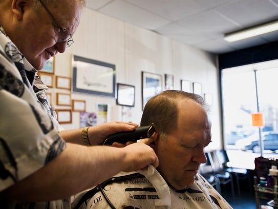 Garry Montague, owner of Garry's Barbershop in Essex