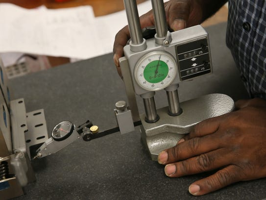 Fabian Smith, Rochester, learns to inspect mechanical
