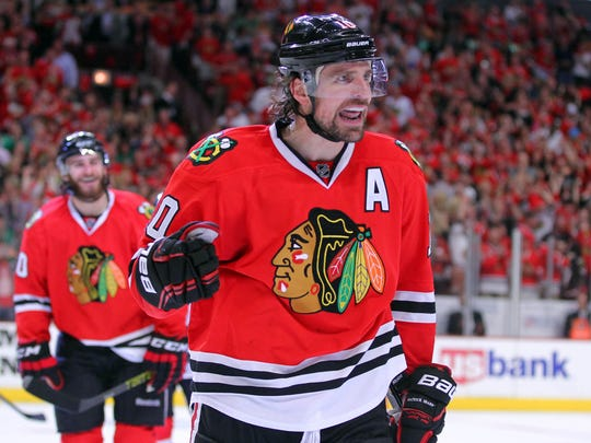 Jun 1, 2014: Chicago Blackhawks left wing Patrick Sharp (10) celebrates his goal during the second period in game seven of the Western Conference Final of the 2014 Stanley Cup Playoffs against the Los Angeles Kings at the United Center.