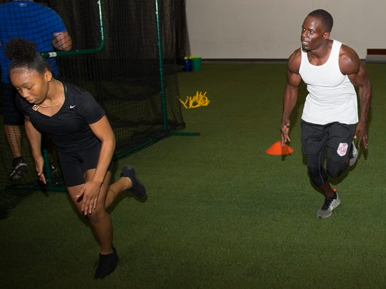 Skylar Seldon, 12, left, trains with Noel Devine, center, on Wednesday at Cape Coral Indoor Athletics. The facility opened this month and features multi-sport performance training, summer camps, batting cages and speed and conditioning classes.