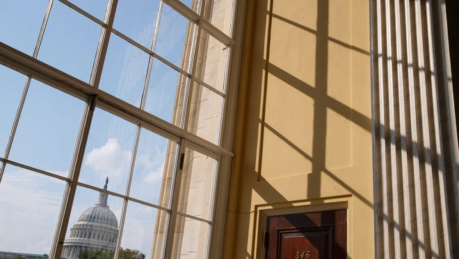 In this June 9, 2014, photo, the Capitol is seen from the Cannon House Office Building in Washington. Political polarization in America has broken out of the voting booth. A new survey from the Pew Research Center finds Americans are divided by ideology and partisanship not only when they cast ballots, but also in choosing where to live, where to get their news and with whom to associate. And peaceful coexistence is increasingly difficult.  (AP Photo/J. Scott Applewhite)