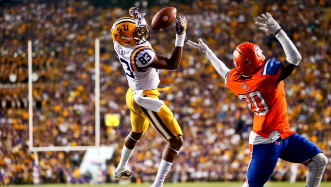 LSU Tigers wide receiver Travin Dural (83) catches a touchdown over Sam Houston State Bearkats cornerback Ernest Payton (20) during the first half of a game at Tiger Stadium.