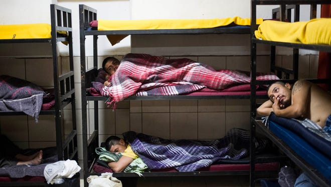 Deportees sleep at the San Juan Bosco shelter in Nogales, Sonora, after being caught by the Border Patrol and sent back to Mexico.