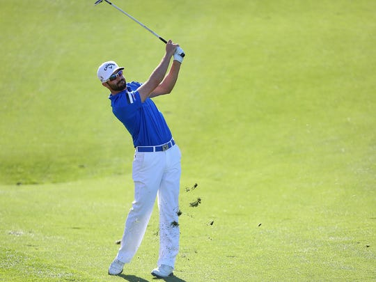 Adam Hadwin hits a shot during the final round of the CareerBuilder Challenge, January 24, 2016.