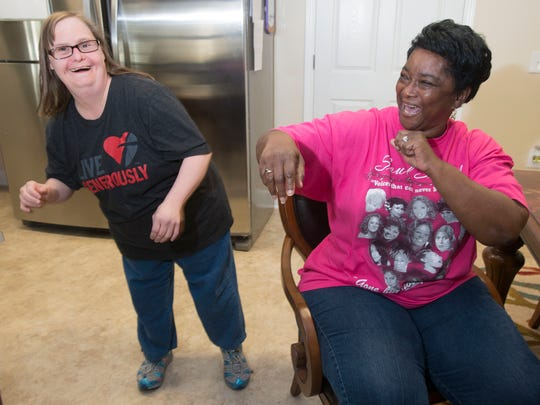 """ARC client, Jennifer, left, and Home Ast. Janetha Henry, right, entertain one another with a song and dance routine to the song """"Tootsie Roll"""""""