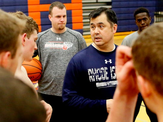 Coach Jon Showers, back left, looks on as coach Pat McGlynn talks to his York Ballers players during practice at York High School in 2017. McGlynn has stepped down as the Ballers' head coach and president after 16 years. Dawn J. Sagert photo
