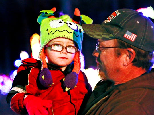 Jace Dunnick, 2, poses for a photo in the arms of his grandfather John Lake Jr., both of Windsor Township, during Christmas Magic at Rocky Ridge County Park in Springettsbury Township, Friday, Nov. 24, 2017. Dawn J. Sagert photo