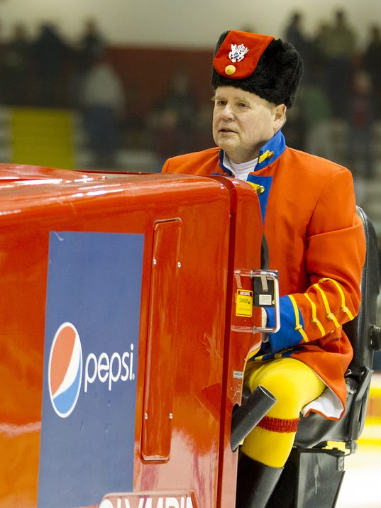 Dave Nulle wears costumes cleaning Cornell hockey ice