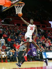 Rutgers Scarlet Knights guard Issa Thiam (35) drives