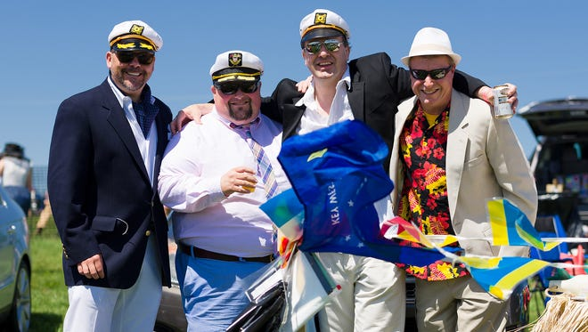 "Wilmington residents Kevin McCabe, Aaron Goldstein, Jim Miller and Brett Englebreth host a ""yacht rock"" tailgate party at Point to Point last year."