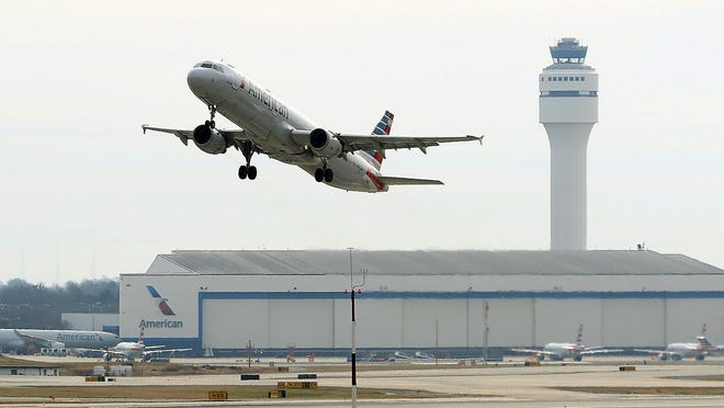 An American Airlines jet takes off from Charlotte Douglas International Airport in this file photo. In June, the airport averaged 355 daily flights, which was down 54 percent from a year earlier.
