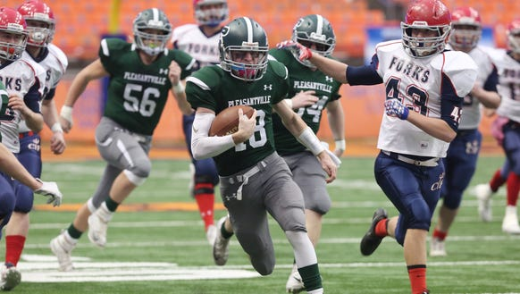 Pleasantville's Jack Howe (18) runs for a first half