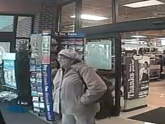 West Bloomfield Police say this suspect was part of an an elaborate role-playing scam that bilked an 80-year-old woman out of $14,000