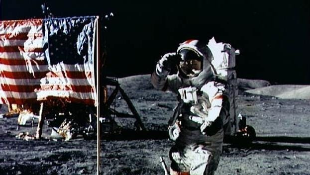 Aldrin salutes the flag he just planted on the Moon. Neil Armstrong was taking pictures of the event at the same time.