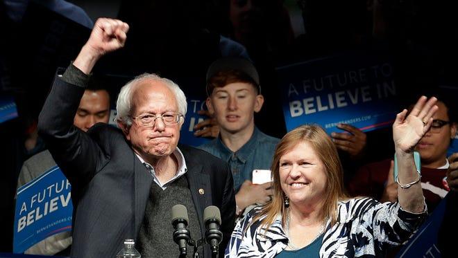 Democratic presidential candidate Sen. Bernie Sanders and his wife, Jane, rally in Louisville, Ky.