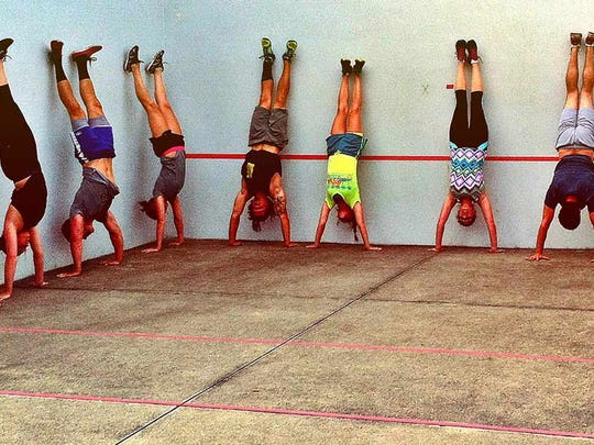 A training session ends with handstands for participants