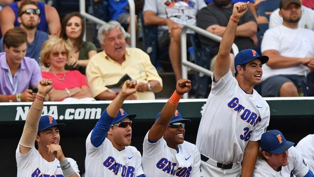 Florida players celebrate a hit against LSU in Game 2 of the College World Series.