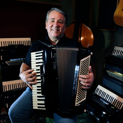 Joey Miskulin in his recording studio with his custom accordions.